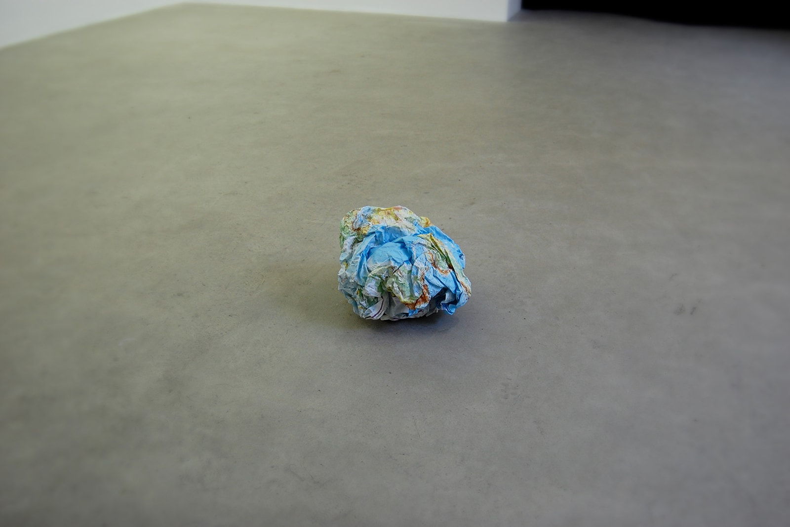World - A crumpled paper map of the world turned into the shape of a globe, 2008