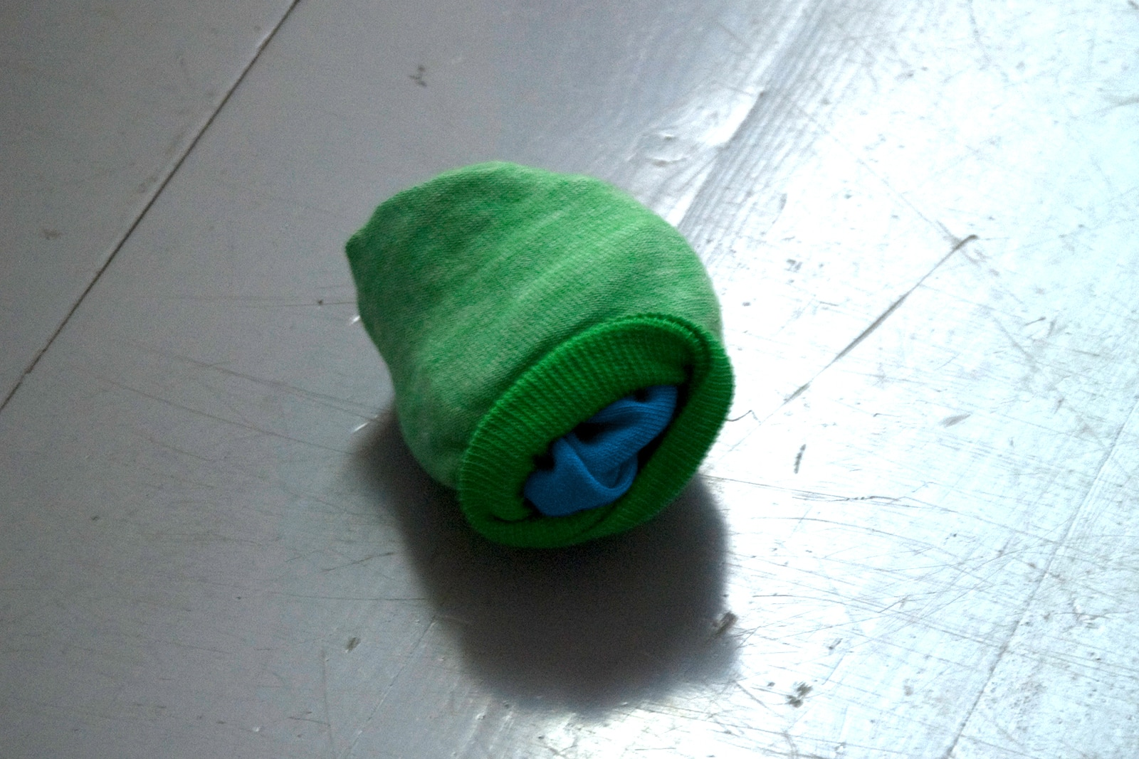 Untitled (World) - Two socks, the color of the world, bundled together.