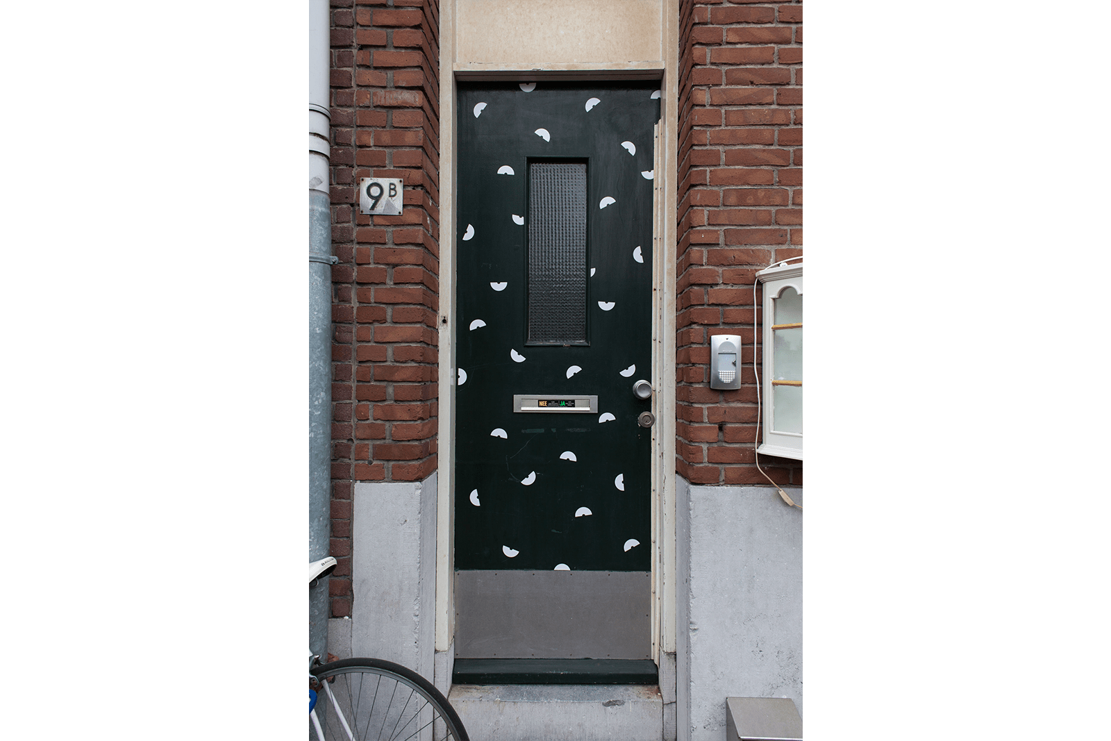 When did you think to mention? by Mathijs van Geest - Smoke alarm warning stickers without warning on front door, 2017